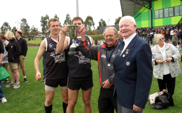 Reserves captains Dan Adams (left) and Ben Fleming celebrate the Premiership with coach Bill Emerson and club legend John Miles. Pic: Phil Skeggs
